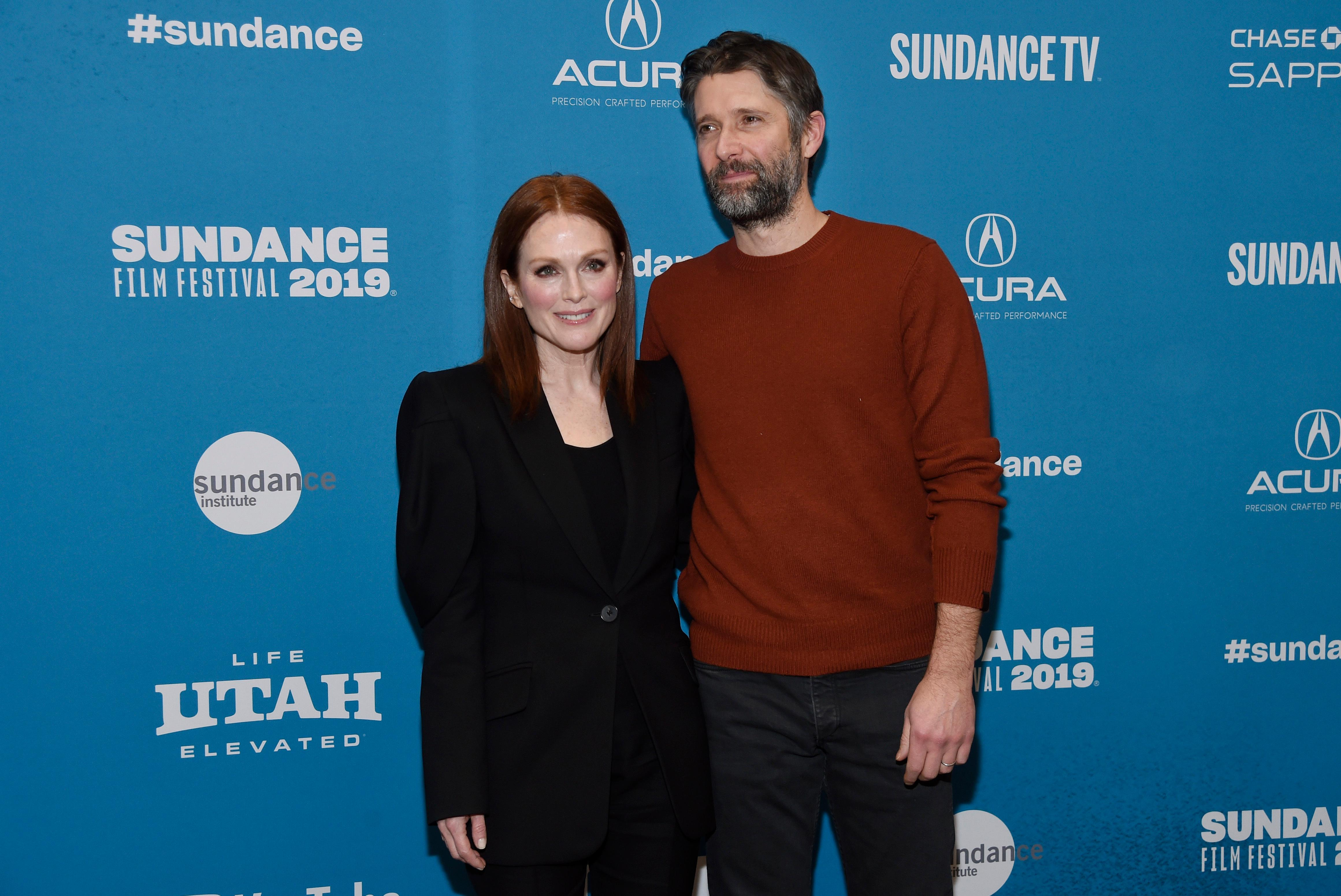 "Bart Freundlich, right, writer/director of ""After the Wedding,"" poses with his wife, cast member Julianne Moore, at the premiere of the film on the opening night of the 2019 Sundance Film Festival, Thursday, Jan. 24, 2019, in Park City, Utah. (Photo by Chris Pizzello/Invision/AP)"