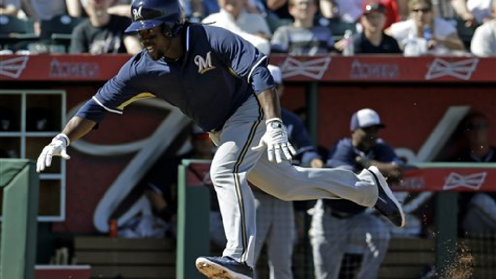 Milwaukee Brewers's Rickie Weeks slides home during the third inning an exhibition spring training baseball game against the Los Angeles Angels Wednesday, March 12, 2014, in Tempe, Ariz. Weeks left the game after the play. (AP Photo/Morry Gash)