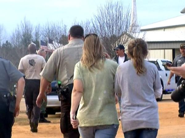 Law enforcement in Midland City, Ala. on January 29, 2013 during a hostage standoff with the man suspected of shooting and killing a school bus driver in Dale County before kidnapping a child.