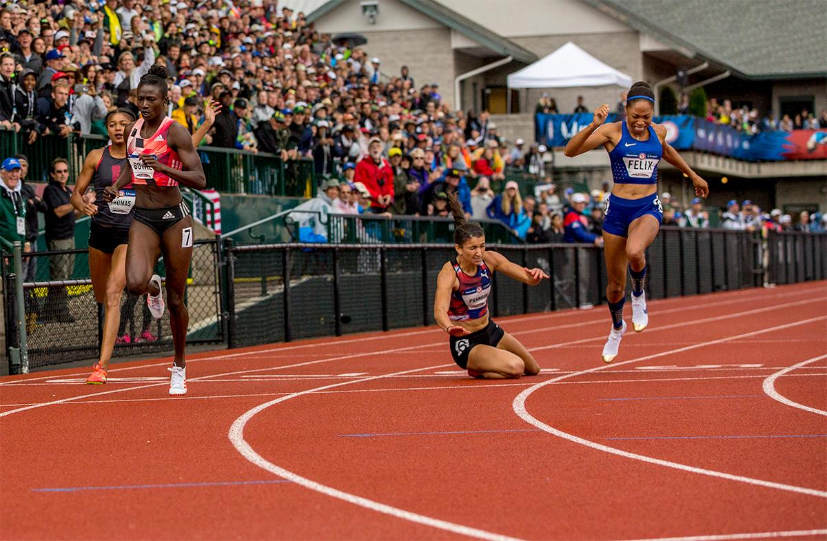 Puma's Jenna Prandini trips to the ground as she and other athletes in the 200 meters hit the line. Prandini finished the race third with a time of 22.53 and punched her ticket for Rio. Photo by August Frank, Oregon News Lab