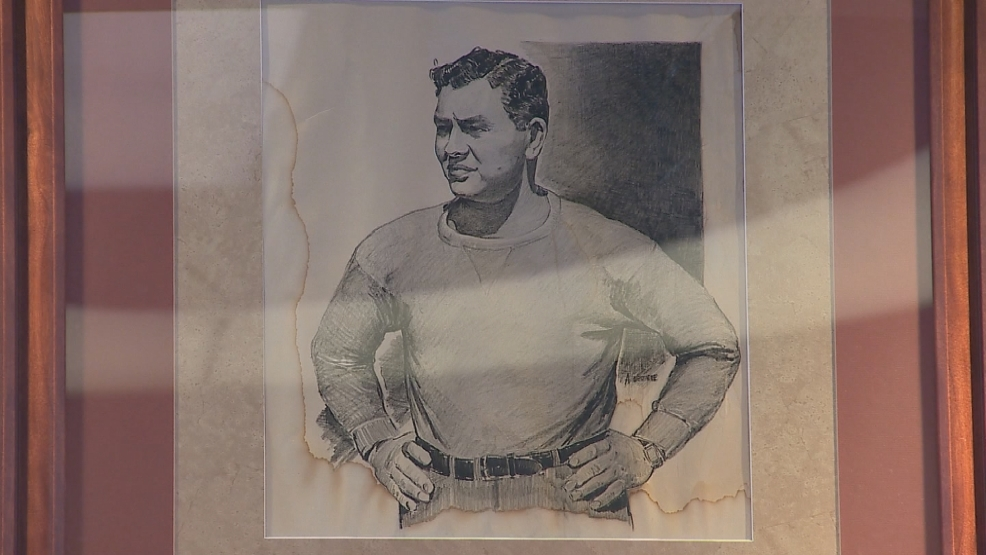 A drawing of Curly Lambeau hangs over the fireplace at Curly's Pub inside Lambeau Field. The drawing is said to be the only artifact to survive the fire at Rockwood Lodge.