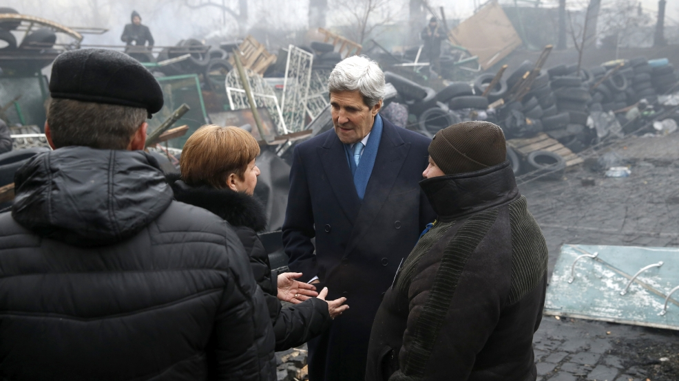 "Secretary of State John Kerry stands beside a barricade at the Shrine of the Fallen in Kiev, Ukraine, Tuesday, March 4, 2014. The Shrine of the Fallen, located on Institutska Street, honors the fallen Heroes of the ""Heavenly Sotnya"" (Hundred). Over the course of the EuroMaidan protests, almost 100 protesters were killed by police. (AP Photo/Kevin Lamarque, Pool)"