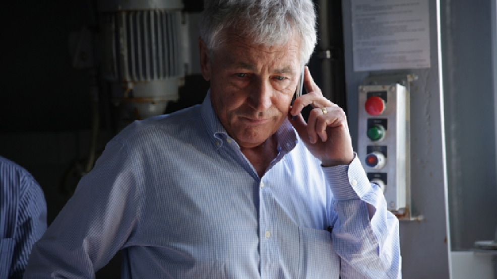 U.S. Secretary of Defense Chuck Hagel receives an update on the phone on the shooting at Fort Hood in Texas, as he was on a tour of the USS Anchorage, an amphibious transport dock ship, with his counterparts from Southeast Asia on Wednesday, April 2, 2014, at Joint Base Pearl Harbor-Hickam in Honolulu, Hawaii. (AP Photo/Alex Wong, Pool)