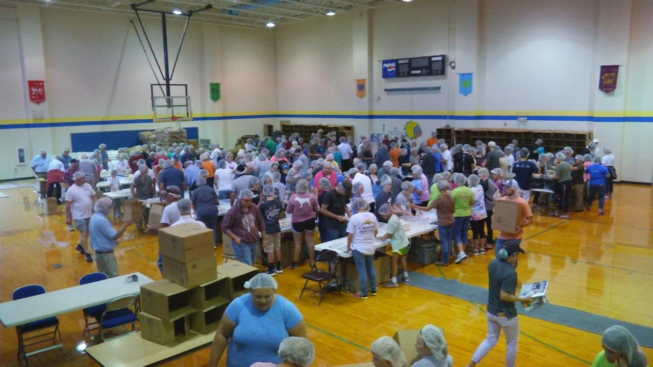 More than 100,000 meals were packed at Pleasant Gardens Elementary School Saturday, for hungry families in Nicaragua. (Photo credit: WLOS staff)