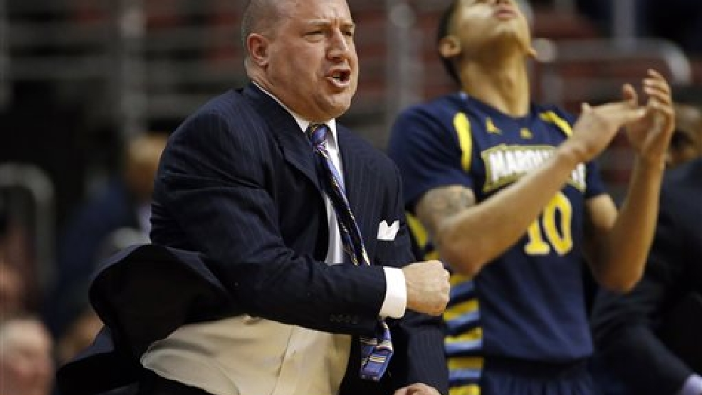 Marquette head coach Buzz Williams reacts to a play during the first half of an NCAA college basketball game against Villanova, Sunday, March 2, 2014, in Philadelphia. (AP Photo/Matt Slocum)