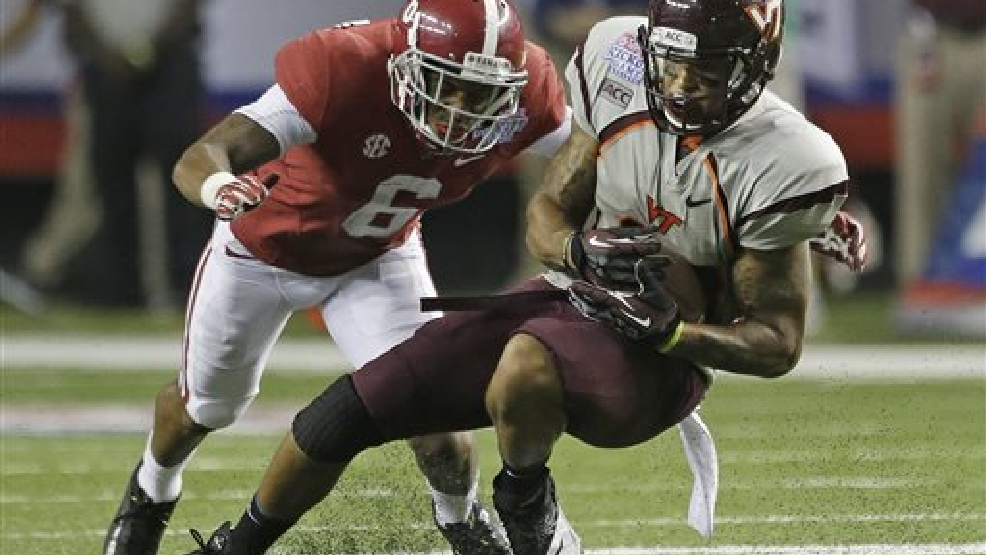 In this Aug. 31, 2013, file photo, Virginia Tech running back Trey Edmunds (14) is stopped by Alabama defensive back Ha Ha Clinton-Dix (6) in the second half of an NCAA college football game in Atlanta. During Clinton-Dix's first season as full-time starter he had 51 tackles and two interceptions. He is a top prospect in the upcoming NFL draft. (AP Photo/Dave Martin, File)